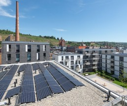 Photovoltaic systems on a roof area of apartment block B