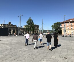 Planners walk from the station square towards the Neue Weststadt