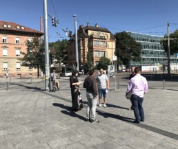 Planners meet at the station square for an inspection of the Neue Weststadt